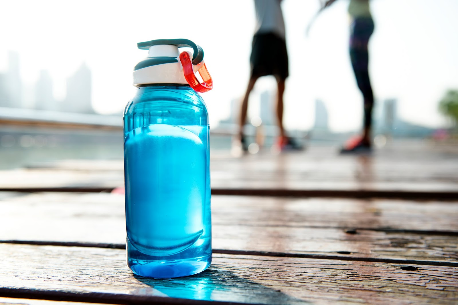 A reuseable and eco-friendly water bottle filled with Goodfor filtered water